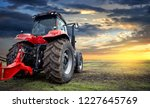 Tractor Working On The Farm At...