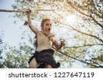 caveman  manly boy with weapon... | Shutterstock . vector #1227647119