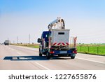 truck carrying trailer with... | Shutterstock . vector #1227655876