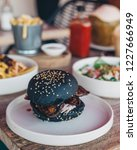 tasty burger served with black...   Shutterstock . vector #1227666949