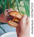 delicious burger holder in hands   Shutterstock . vector #1227667213