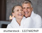 smiling husband embracing... | Shutterstock . vector #1227682969