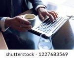 business man using laptop... | Shutterstock . vector #1227683569