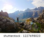 successful woman backpacker... | Shutterstock . vector #1227698023