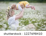 happy family in nature. woman... | Shutterstock . vector #1227698410