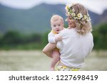 happy family in nature. woman... | Shutterstock . vector #1227698419