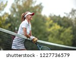 smiling woman in uniform on the ... | Shutterstock . vector #1227736579