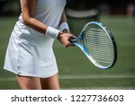 tennis player in sportswear... | Shutterstock . vector #1227736603