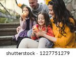 a portrait of young family with ... | Shutterstock . vector #1227751279