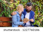man and woman sit bench park....   Shutterstock . vector #1227760186