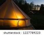 camping canvas bell tent glows...   Shutterstock . vector #1227789223