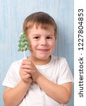 smiling boy holding a candy in...   Shutterstock . vector #1227804853
