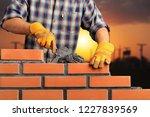 bricklayer industrial worker... | Shutterstock . vector #1227839569