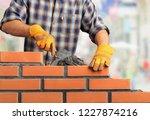 bricklayer industrial worker... | Shutterstock . vector #1227874216
