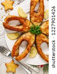 fried carp fish slices on a... | Shutterstock . vector #1227901426