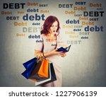 young woman shopaholic carrying ... | Shutterstock . vector #1227906139