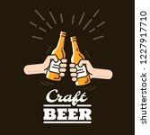 two hands clink bottles with... | Shutterstock .eps vector #1227917710
