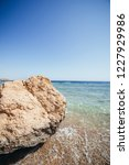 coral beach with a pier ... | Shutterstock . vector #1227929986