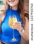 beautiful woman drinking a... | Shutterstock . vector #1227933763