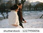 bride and groom walk in winter   Shutterstock . vector #1227950056