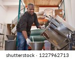 smiling worker pouring melted... | Shutterstock . vector #1227962713