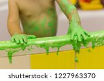 the child plays in the bathroom ...   Shutterstock . vector #1227963370