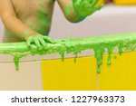 the child plays in the bathroom ...   Shutterstock . vector #1227963373