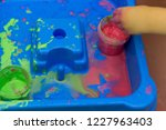 the child plays in the bathroom ...   Shutterstock . vector #1227963403
