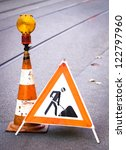 Men At Work Sign At A Road...