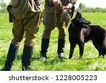 soldiers with a german shepherd ... | Shutterstock . vector #1228005223