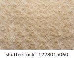 beige natural wool with twists... | Shutterstock . vector #1228015060