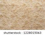 beige natural wool with twists... | Shutterstock . vector #1228015063