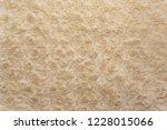 beige natural wool with twists... | Shutterstock . vector #1228015066