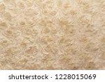 beige natural wool with twists... | Shutterstock . vector #1228015069