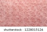 pink natural wool with twists... | Shutterstock . vector #1228015126