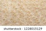 beige natural wool with twists... | Shutterstock . vector #1228015129