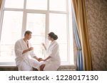 man and woman in white coats at ... | Shutterstock . vector #1228017130