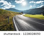 road in mountain valley at... | Shutterstock . vector #1228028050