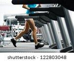 woman runs on a treadmill ... | Shutterstock . vector #122803048