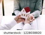 home agents are giving house... | Shutterstock . vector #1228038820