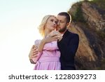 man and a woman hugging in the... | Shutterstock . vector #1228039273