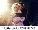 man and a woman hugging in the... | Shutterstock . vector #1228039279