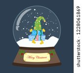 christmas snow globe on the... | Shutterstock . vector #1228061869