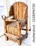 old wooden chair with spikes... | Shutterstock . vector #1228096720