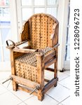 old wooden chair with spikes... | Shutterstock . vector #1228096723