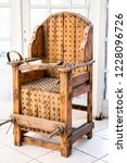 old wooden chair with spikes... | Shutterstock . vector #1228096726