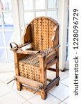 old wooden chair with spikes... | Shutterstock . vector #1228096729