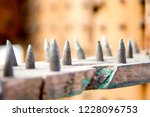 old wooden chair with spikes... | Shutterstock . vector #1228096753