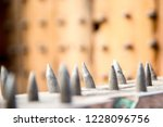 old wooden chair with spikes... | Shutterstock . vector #1228096756