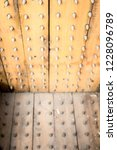 old wooden chair with spikes... | Shutterstock . vector #1228096789